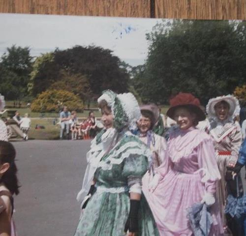 edwardian dressed ladies walking across the grounds of croxteth hall