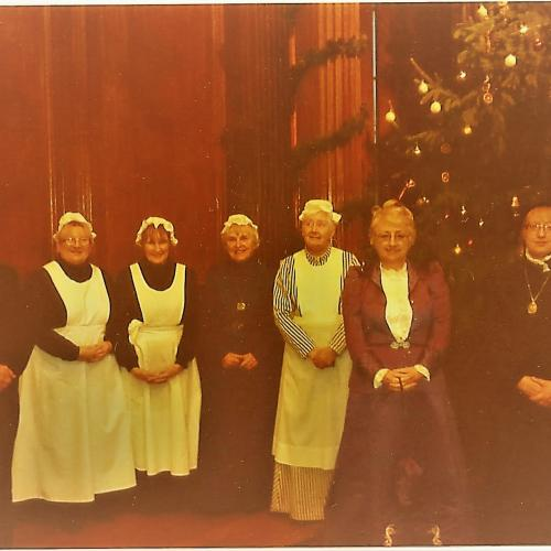 Heritage Volunteers pose with Croxteth Hall's butler during Victorian Christmas